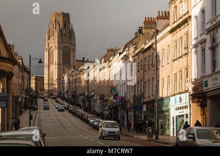Park Street, Bristol, in evening sunshine with dark storm clouds; the Wills Tower, University of Bristol, and Georgian - Stock Image