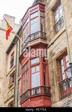 Typical enclosed balconies on houses in Gijon, Spain - Stock Image