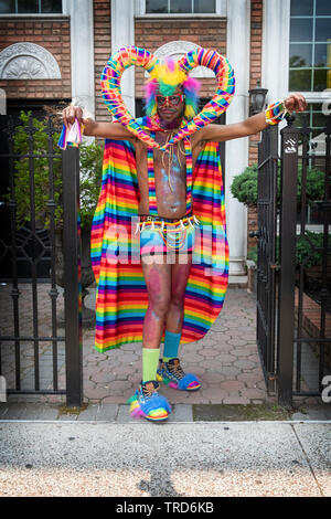 Posed portrait of a marcher at the 2019 Queens Pride Parade in Jackson Heights, NYC marching to promote his business. - Stock Image