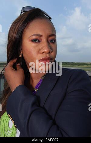 Lady wearing beaded necklace pose - Stock Image