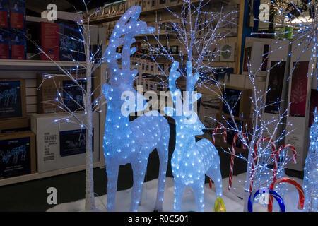 Christmas illuminated reindeer decorations on display - Stock Image
