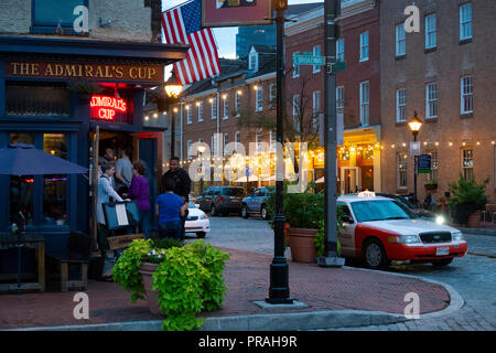 USA Baltimore Fells Point outside The Admirals Cup bar tavern on Thames Street evening taxi - Stock Image