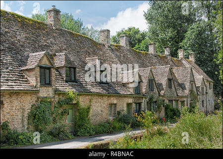 Pretty cottages of Arlington Row situated in the historical Bibury village, Gloucestershire England UK - Stock Image