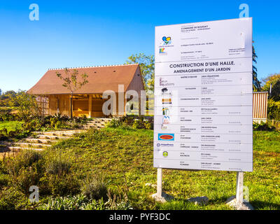 Contractors details on notice board for new timber construction of village hall - France. - Stock Image