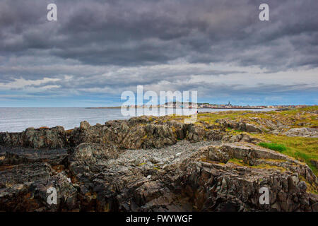 The town Vardø seen from Skagen on a stormy summer day. Varanger region in arctic Norway. - Stock Image