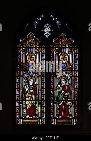 Stained glass window depicting Apostles, St John and St James the Great, All Saints Church, Beighton, Norfolk - Stock Image