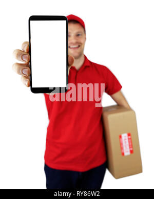 smiling delivery man showing smartphone with blank screen - Stock Image