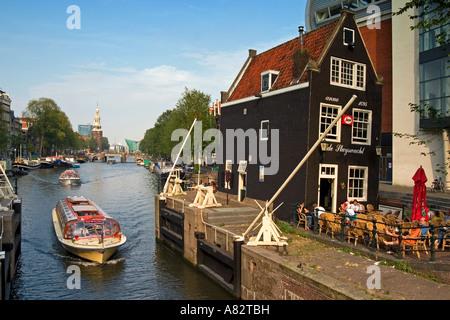 Amsterdam historic building 1695 draw bridge Cafe de Slyswacht Canal boat background Oude Schans Motelbaans Toren - Stock Image