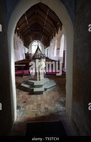 Baptismal font in church of Ilketshall St Andrew, Suffolk, England, UK - Stock Image