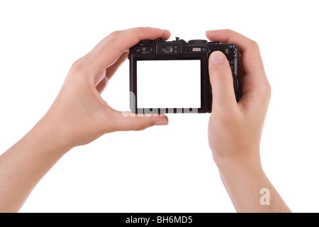 Hand photographing with a digital camera isolated on white - Stock Image