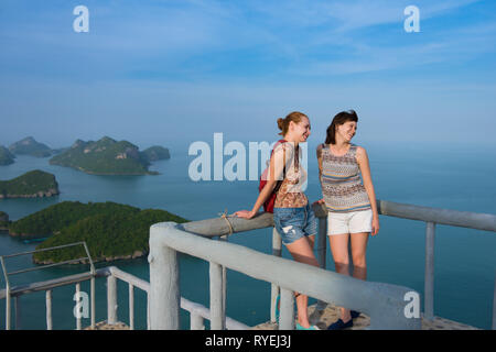 Two female tourists on top of the Ko Wua Ta Lap island in Ang Thong national marine park - Stock Image