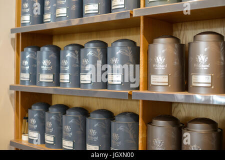 Cannisters conatining loose leaf tea on shelves shelving in a Whittard shop Whittard's, York UK. - Stock Image