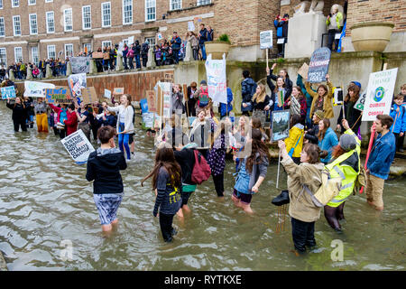 Bristol, UK. 15th March, 2019. Bristol college students and school children carrying climate change placards and signs are pictured standing in the moat outside Bristol City Hall as they protest against Climate change. The pupils who also went on strike last month walked out of school again today as part of a countrywide coordinated strike action to force action on climate change policy. Credit: lynchpics/Alamy Live News - Stock Image