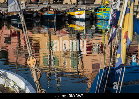 Sanary sur Mer, France,- September 2018: colours reflected in the harbour - Stock Image