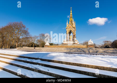 London, UK - February 2, 2018: The Royal Albert Memorial in Hyde Park covered in snow - Stock Image