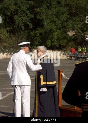 The Hon Judge John Alcantara CBE, the Mayor of Gibraltar, talking with a senior Naval Officer dignitary dignitaries - Stock Image