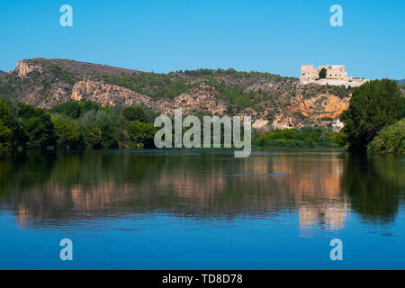 a view of the Ebro River as it passes through Miravet, Spain, highlighting its Templar castle in the top of the hill - Stock Image