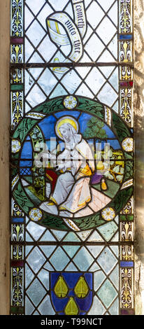 Stained glass window of Saint Anne in church of Saint Margaret, South Elmham, Suffolk, England, UK c 1917 - Stock Image
