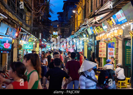 Night shot of Ta Hien Street in Hanoi's Old Quarter, Vietnam. The narrow street, which comes to life only at night, houses several small bars and rest - Stock Image