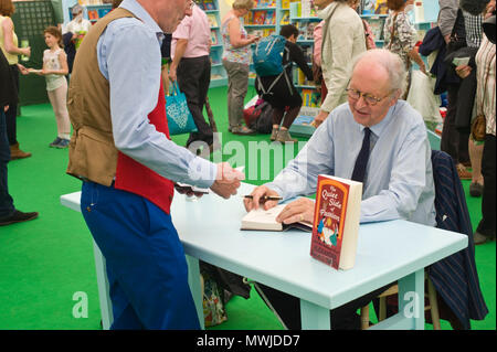 Alexander McCall Smith signing books for fans in the bookshop at Hay Festival 2018 Hay-on-Wye Powys Wales UK - Stock Image