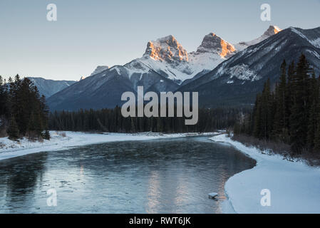 Three Sisters sunset with Bow River, Canmore, Alberta, Canada, Canadian Rockies - Stock Image