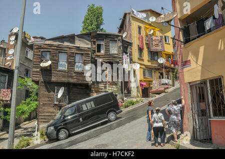 An old wooden house on a steep street in a old residential neighbourhood in Istanbul - Stock Image