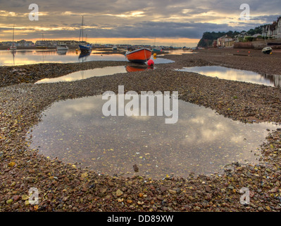 The vibrantly painted fishing boat 'Dixie',  in the  early morning light, on the shingle beds of the 'The Salty', - Stock Image