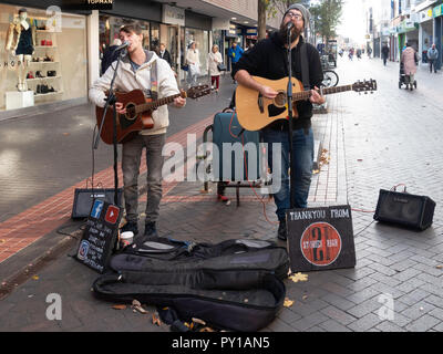 Two men street musicians called 21 Stories High singing and playing guitar  in Middlesbrough town centre - Stock Image