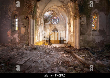 Interior view of an abandoned church in France. - Stock Image