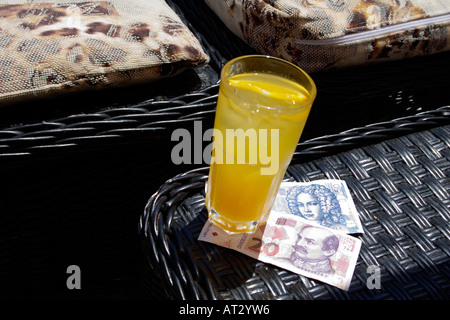 Kuna (HRK) Croatian currency and glass of orange juice - Stock Image