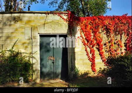 Paris, France - 'Pere Lachaise Cemetery', Locked Door on Garden Wall in Autumn - Stock Image