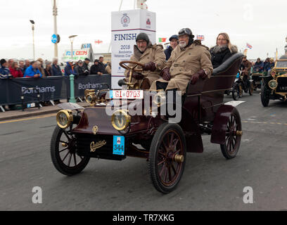 Mr Christian Bender driving his 1904 Cadillac, across the finishing line at the end of the 2018 London to Brighton Veteran Car Run - Stock Image