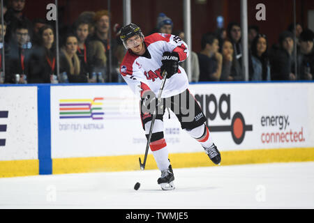 Melbourne, Victoria, Australia. 21st June 2019. 2019 Ice Hockey Classic, Canada versus USA; James Bettauer of Canada moves the puck forward Credit: Action Plus Sports Images/Alamy Live News - Stock Image