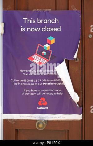 Sign on doorway of closed down National Westminster Bank (Nat West Bank) Stamford High Street Branch, Lincolnshire, England, UK - Stock Image