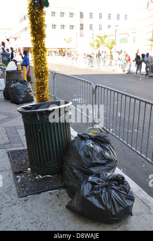 Garbage bags on sidewalk, Nassau, Bahamas - Stock Image