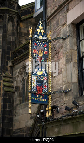 Ornate and colourful signage for the Witchery on Edinburghs Royal Mile - Stock Image