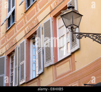 Lamp and windows with shutters,Sestri Levante, Liguria, Italy - Stock Image