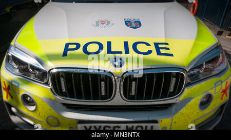 Front view of a BMW UK police car bonnet and dirty grill - Stock Image