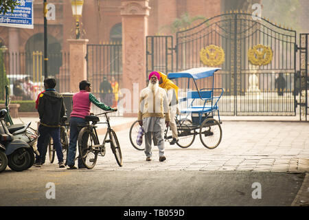 Sikhs people and tourists are walking through the streets of Amritsar, Punjab, India. - Stock Image