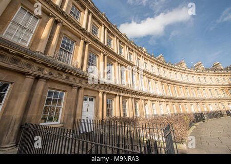 View of stunning Georgian houses in The Circus, Bath, with traditional iron railings, curved parrellel lines, columns built in creamy Bath stone - Stock Image