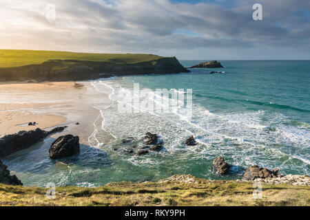 Incoming tide at Porth Joke Beach on the North Cornwall coast in England. - Stock Image