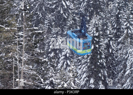 Cable car swaying over the trees. Golte ski resort. Slovenia. - Stock Image