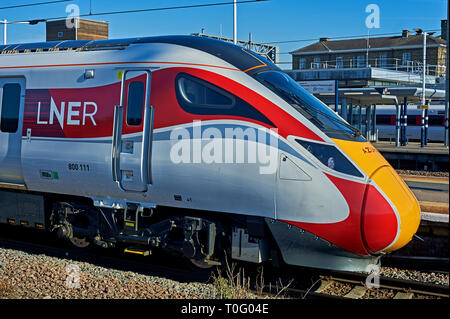New Azuma streamlined trains in LNER railway livery at Peterborough station. - Stock Image