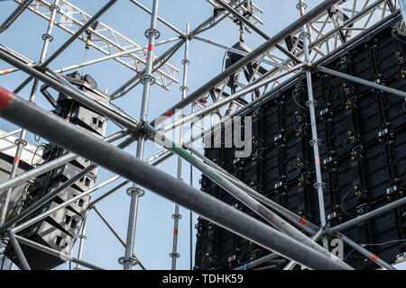Behind of the LED monitor display on scaffold scene and speakers - Stock Image