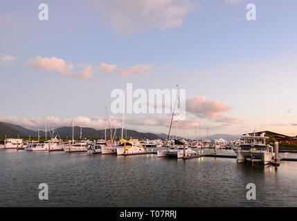 Atmospheric view of Cairns Marina at sunset, Far North Queensland, FNQ, QLD, Australia - Stock Image