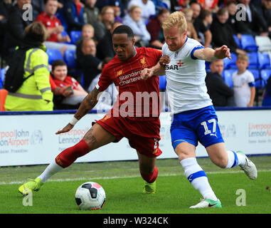 Birkenhead, Wirral, UK. 11th July 2019; Prenton Park, Tranmere, England; Pre-season friendly football, Tranmere versus Liverpool; Nathaniel Clyne of Liverpool takes on David Perkins of Tranmere Rovers Credit: Action Plus Sports Images/Alamy Live News - Stock Image