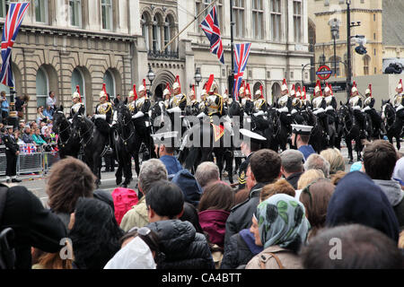 London, UK. June 5, 2012. Crowds line Parliament Street as a The Household Cavalry passes by shortly after leaving - Stock Image