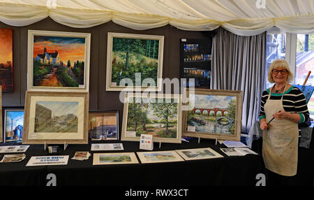 The artist Bernice Tackley exhibiting her paintings in the marquee at The Anderton boat lift. Cw 6617 - Stock Image
