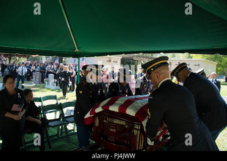 California Army National Guard Funeral honors team Carries the casket of Major Gen (Ret.) Nhia Bee Lee. At the Sierra memorial lawn in Nevada City California. This is the first time US honors were presented to a Hmong General who fought on the side of the US during Vietnam. - Stock Image