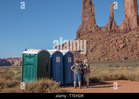 MONUMENT VALLEY, near KAYENTA, AZ, USA-10/2/15:  Three women stand talking while waiting for access to portable toilets in Monument Valley. - Stock Image